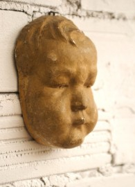 Baby face, antique plaster