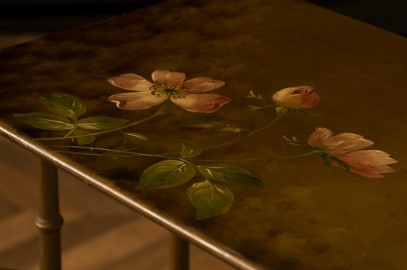 Floral painted pedestal tables early twentieth.