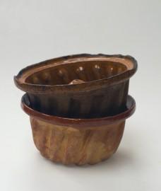 Two old Kouglof molds glazed earthenware.