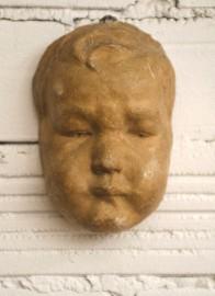 Platre mural, visage de bébé